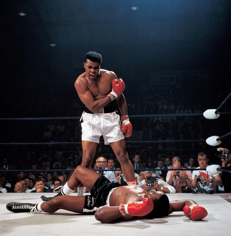 Muhammad Ali after first round knockout of Sonny Liston during World Heavyweight Title fight at St. Dominic's Arena in Lewiston, Maine on 5/25/1965.  (Item # 1001)